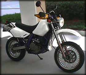 In the white with smaller front wheel, round headlight, IMS tank